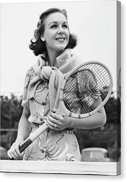 Portrait Of Woman With Racquet On Tennis Court Canvas Print by George Marks