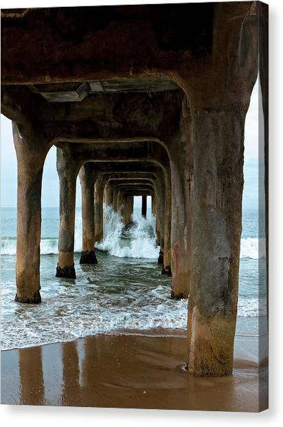 Canvas Print featuring the photograph Pounded Pier by Lorraine Devon Wilke