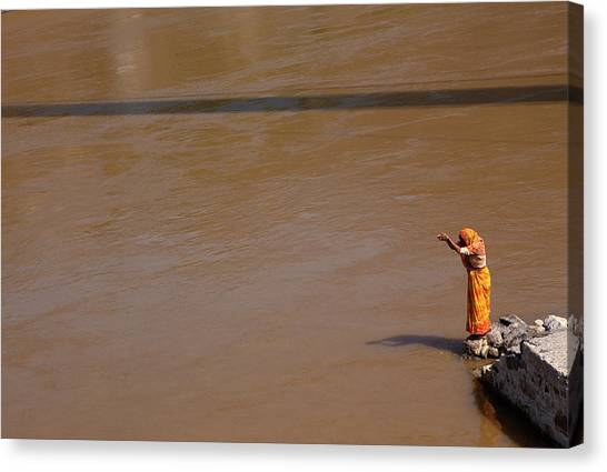 Ganges Canvas Print - Praying On  Banks Of Holy Ganges In Rishike by Claude Renault