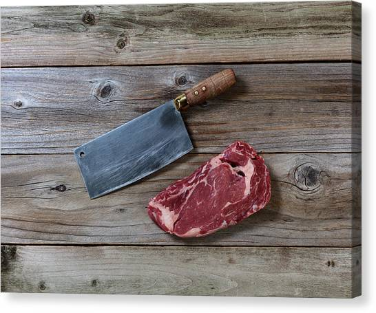 Ribeye Canvas Print - Prime Beef Steak With Butcher Knife On Rustic Wood  by Thomas Baker