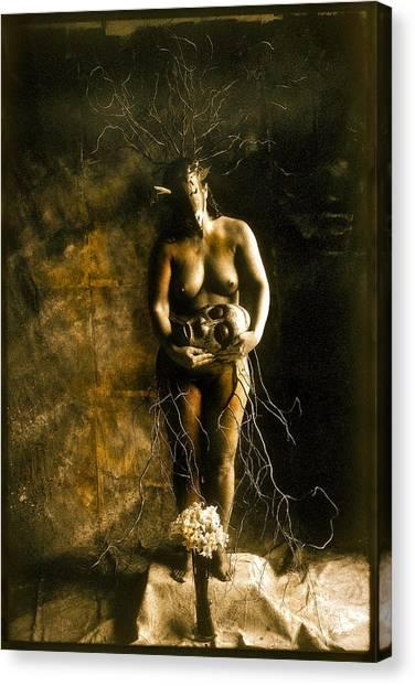 Primitive Woman Holding Mask Canvas Print