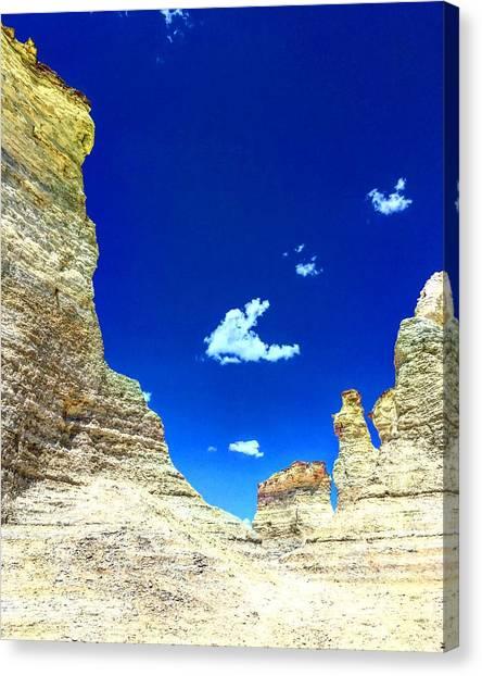 Pristine Sky Meets Historic Rocks Canvas Print