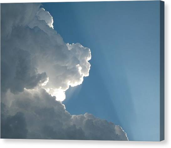 Puffy White Clouds Canvas Print by Liz Vernand