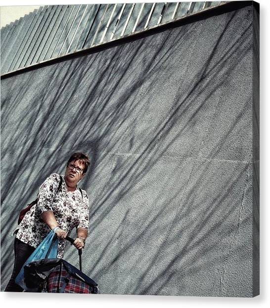 Women Canvas Print - Pushing Lady #woman #streetphotography by Rafa Rivas