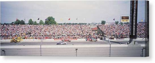 Racecar Drivers Canvas Print - Racecars On A Motor Racing Track by Panoramic Images