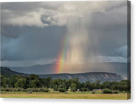 Canvas Print featuring the photograph Rainbow Storm Over Log Hill by Denise Bush