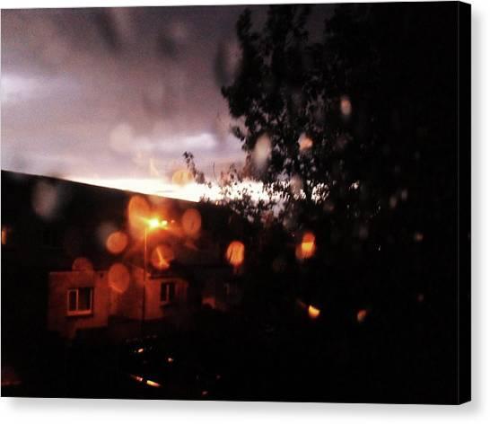 Rainy Sunset Canvas Print by Chrisselle Mowatt