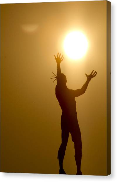 Raising The Sun Canvas Print