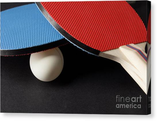 Red And Blue Ping Pong Paddles - Closeup On Black Canvas Print