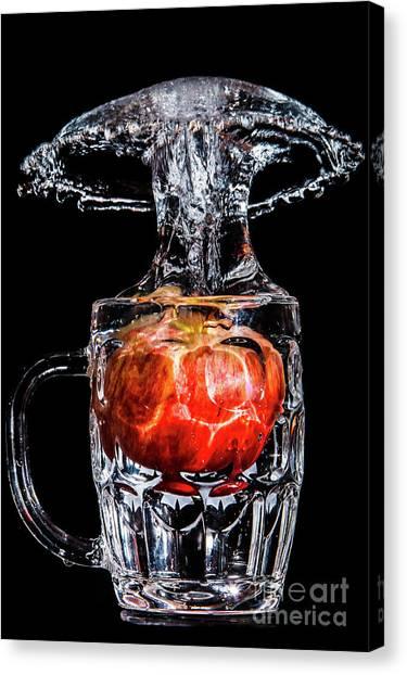 Canvas Print featuring the photograph Red Apple Splash by Ray Shiu