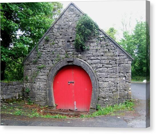 Red Barn Door In Ireland Canvas Print by Jeanette Oberholtzer