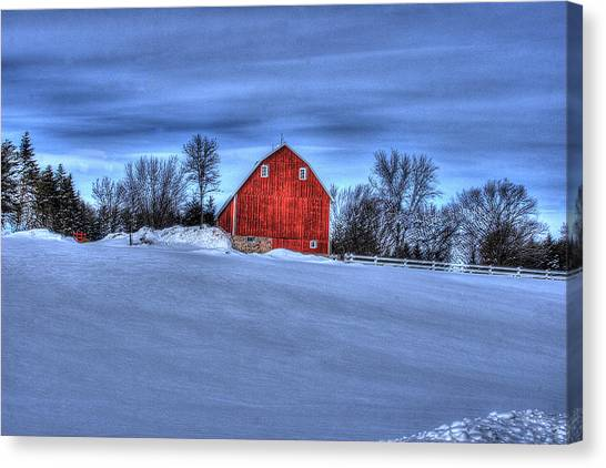 Red Barn In Winter Canvas Print by Laurie Prentice