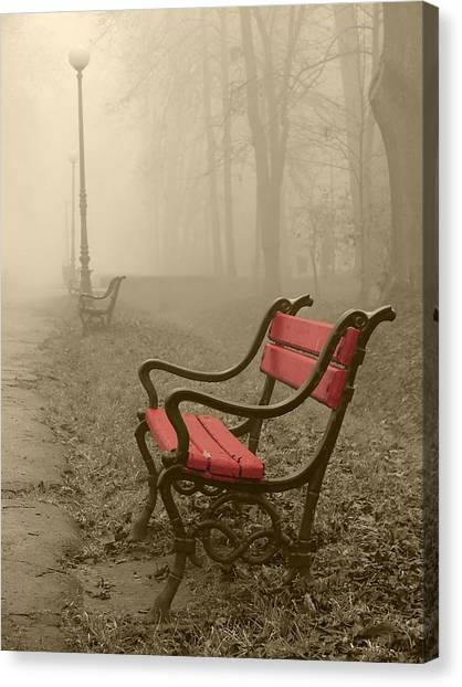 Red Bench In The Fog Canvas Print by Jaroslaw Grudzinski
