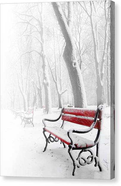 Xmas Canvas Print - Red Bench In The Snow by  Jaroslaw Grudzinski