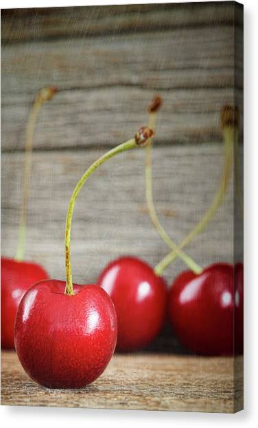 Red Cherries On Barn Wood Canvas Print