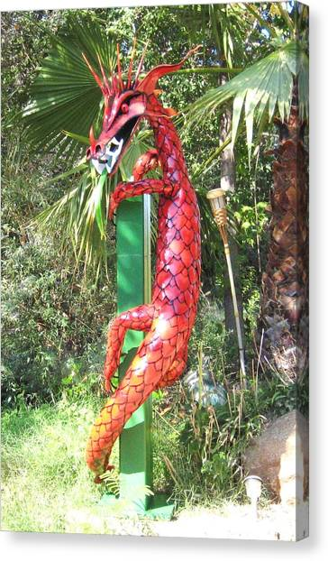 Red Dragon On Post Canvas Print by Robert Findley