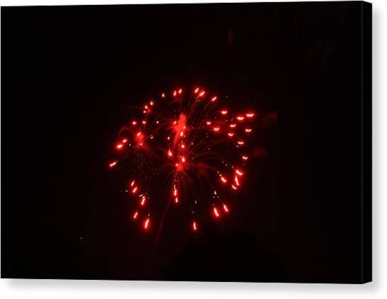 Red Fireworks Canvas Print by JoAnn Tavani