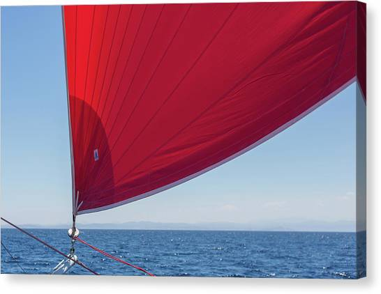 Canvas Print featuring the photograph Red Sail On A Catamaran 2 by Clare Bambers