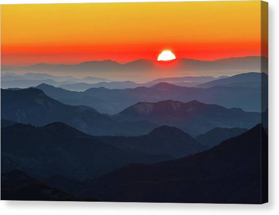 Red Sun In The End Of Mountain Range Canvas Print