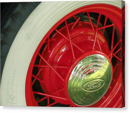 Red Wheels Canvas Print by Richard Mansfield