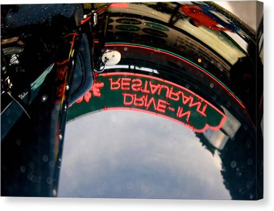 Reflected Neon Sign In Car Hood Canvas Print