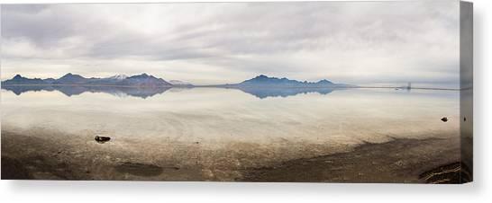 Reflection At Bonneville Salt Flats Canvas Print by Mark Spomer