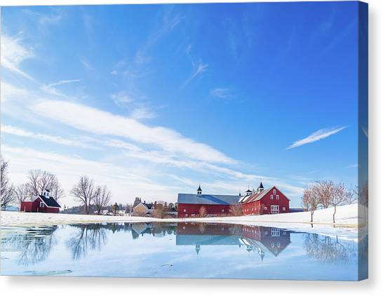 Reflection Of A Barn In Winter Canvas Print