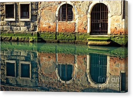 Reflection On Canal In Venice Canvas Print by Michael Henderson