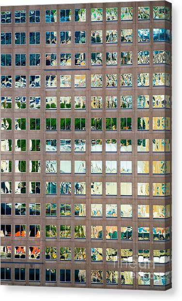 Canvas Print featuring the photograph Reflections In Windows Of Office Building by Bryan Mullennix