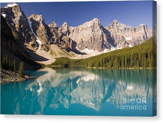 Reflections Of Moraine Lake Canvas Print by Andrew Serff
