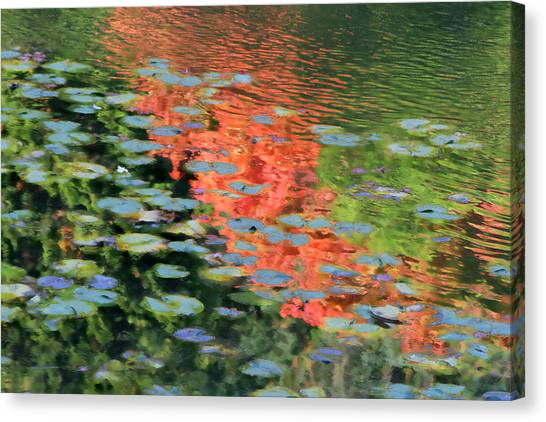 Reflections On A Lily Pond Canvas Print