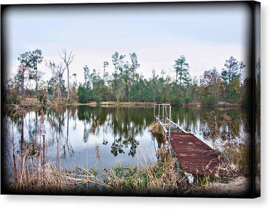 Reflections On The Lake Canvas Print by Bill Perry