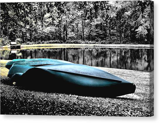 Resting Canoes Canvas Print by Greg Sharpe