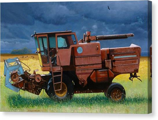 Retired Combine Awaiting A Storm Canvas Print by Doug Strickland