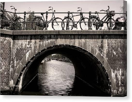 Canvas Print featuring the photograph Retro Bicycles Amsterdam Bridge by Georgi Djadjarov