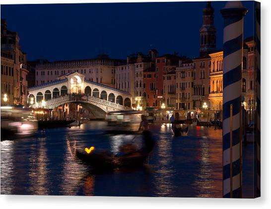 Rialto Bridge In Venice At Night With Gondola Canvas Print by Michael Henderson