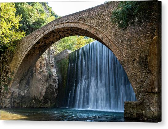 Canvas Print featuring the photograph River Bridge by Nikos Stavrakas
