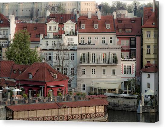 Riverside Below Prague Castle Canvas Print by Marek Boguszak
