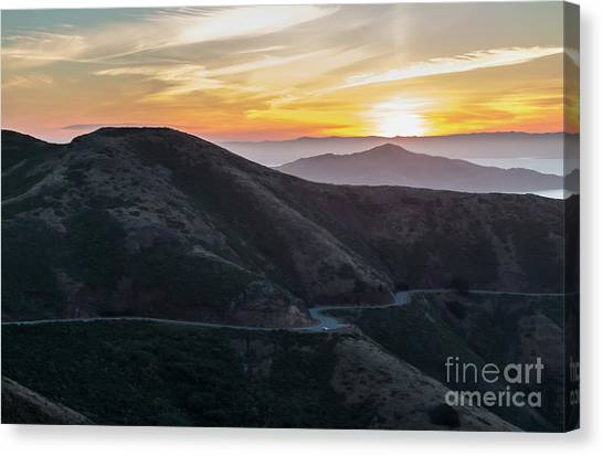 Road On The Edge Of The Mountain With Sunrise In The Background Canvas Print