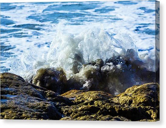 Wave Meets Rock Canvas Print