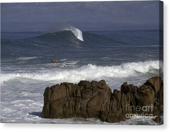 Rock And Wave Canvas Print by Stan and Anne Foster