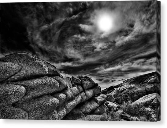Rock Ledge With Swirling Sky Canvas Print by Gary Zuercher
