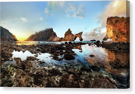 Canvas Print featuring the photograph Rocky Beach Sunrise, Bali by Pradeep Raja Prints