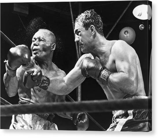 Candids Canvas Print - Rocky Marciano Landing A Punch by Everett