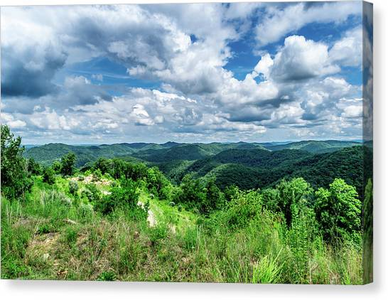 Rolling Hills And Puffy Clouds Canvas Print