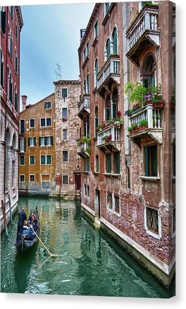 Gondola Ride Surrounded By Vintage Buildings In Venice, Italy Canvas Print