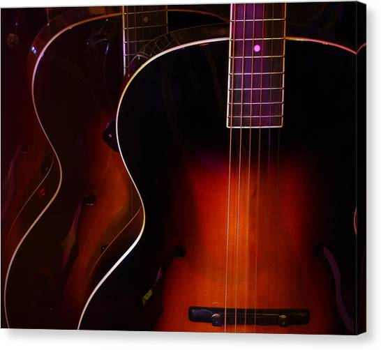 Row Of Guitars Canvas Print