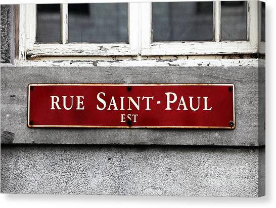 Rue Saint-paul Canvas Print by John Rizzuto