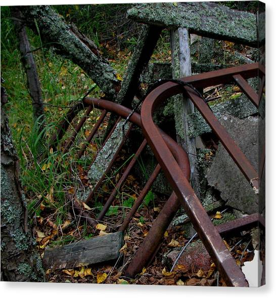 Rusted Bed Frame At Jackfish Ontario Canvas Print by Laura Wergin Comeau