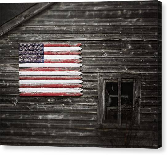 American Flag Canvas Print - Rustic American Flag On A Weathered Grey Barn by Lisa Russo